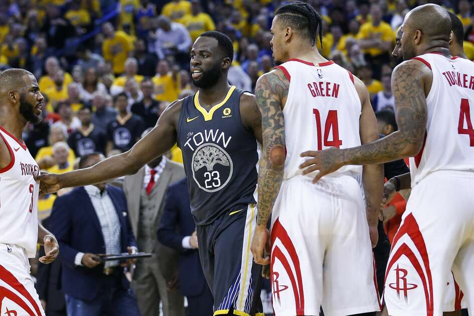 Houston Rockets guard Chris Paul (3), guard Gerald Green (14)] and forward PJ Tucker (4) surround Golden State Warriors forward Draymond Green (23) during the first half of Game 4 of the Western Conference Finals at Oracle Arena Tuesday, May 22, 2018 in Oakland. (Michael Ciaglo / Houston Chronicle)