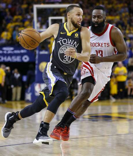 Golden State Warriors guard Stephen Curry (30) takes the ball past Houston Rockets guard James Harden (13) during the second half of Game 4 of the Western Conference Finals at Oracle Arena Tuesday, May 22, 2018 in Oakland. (Michael Ciaglo / Houston Chronicle) Photo: Michael Ciaglo/Houston Chronicle