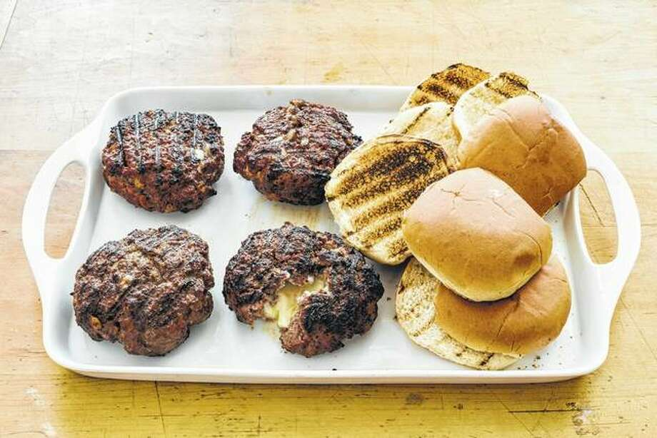 Jucy Lucy burgers are cooked well-done to melt the cheese inside, but that doesn't mean they have to be dry. Photo:       Daniel J. Van Ackere | America's Test Kitchen Via AP