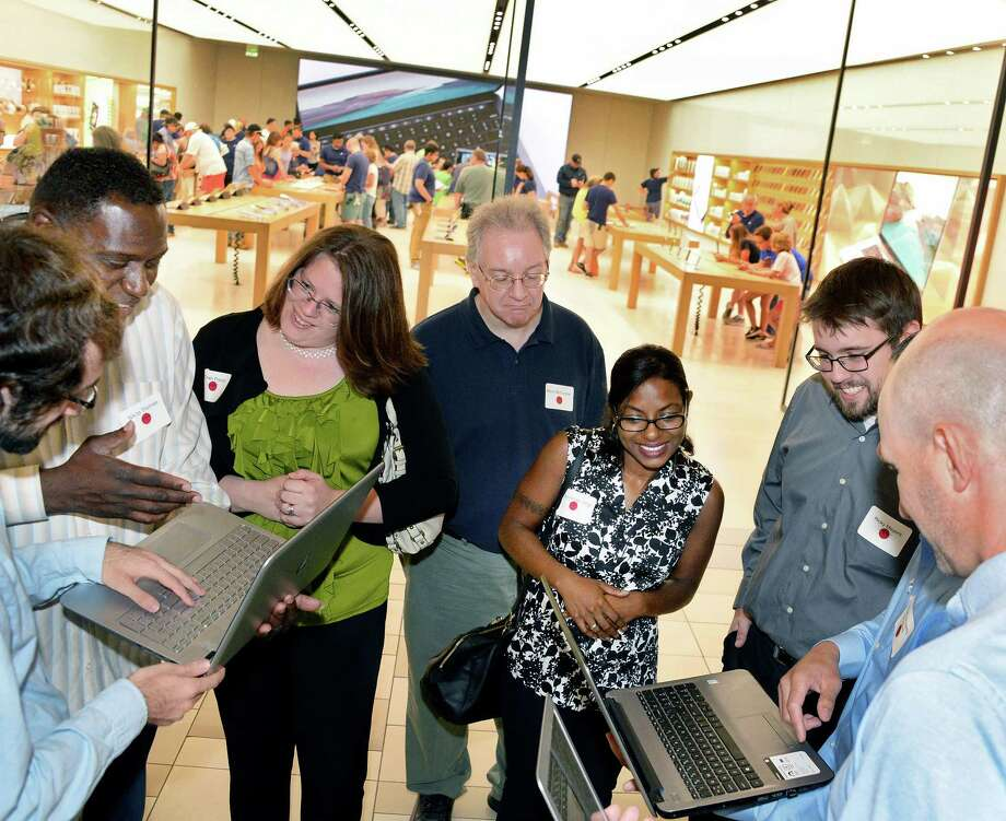 Students and mentors network during Albany Can Code's first anniversary event at the Apple store at Crossgates Mall Tuesday July 11, 2017 in Guilderland, NY.  (John Carl D'Annibale / Times Union) Photo: John Carl D'Annibale, Albany Times Union / 40041018A