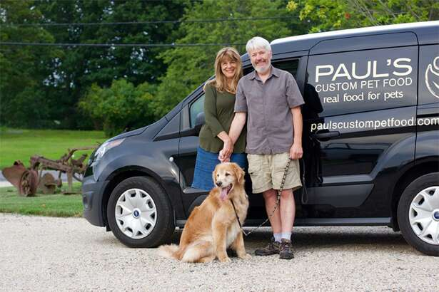 Lynn Felici-Galland, Paul Gallant and Hunter with their Paul's Custom Pet Food van in New Milford. The natural pet food company recently launched a subscription service for customers.