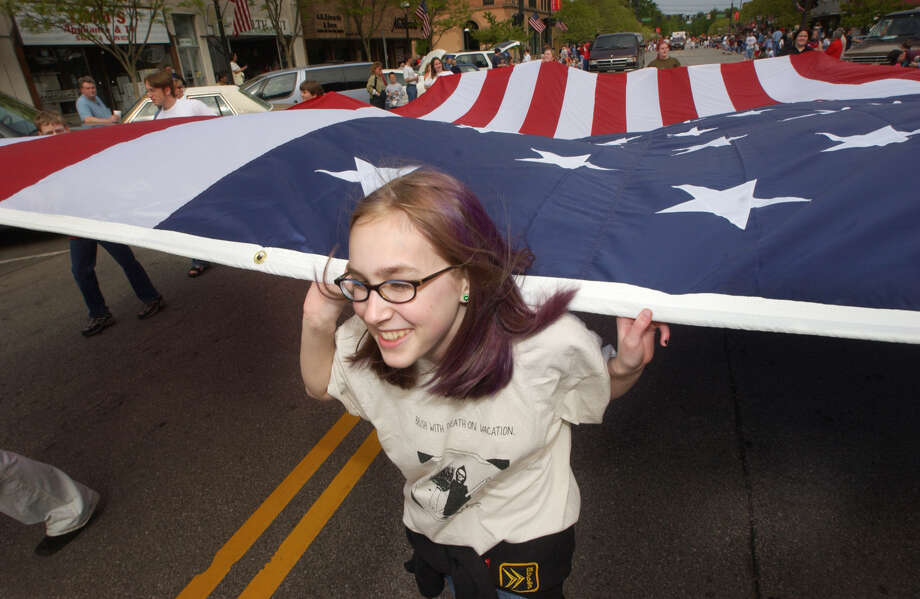 "Coco Smith, student at Central High School, did not plan to carry the American flag during Monday's Memorial Day parade.  She was simply a bystander and was asked to help carry the flag, because they were shorthanded. ""It made me very proud, because I've never walked in a parade,"" says Smith. 2002 Photo: Daily News File Photo"