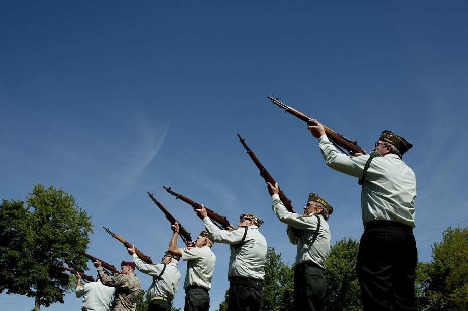 Members of the VFW Post 1071 Rifle Squad participate in a 21 Gun Salute during a Memorial Day and dedication ceremony at the Coleman Veterans Memorial on Monday. 2013 Photo: Daily News File Photo