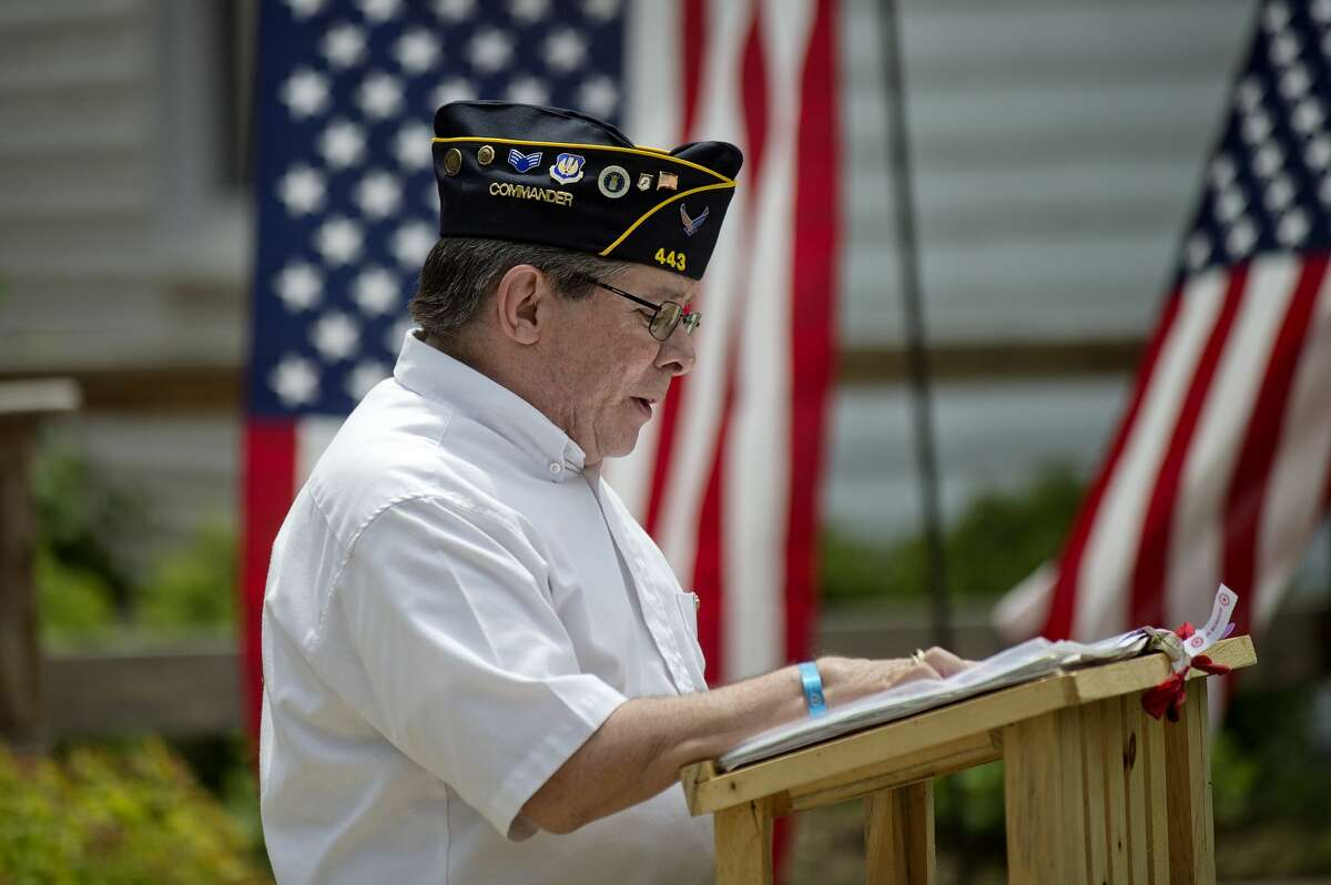 NICK KING | nking@mdn.net Sanford American Legion Post 443 Commander Mark Authier speaks to the crowd during a veterans' tribute ceremony on Saturday at the Sanford Centennial Museum's veterans' memorial. 2016