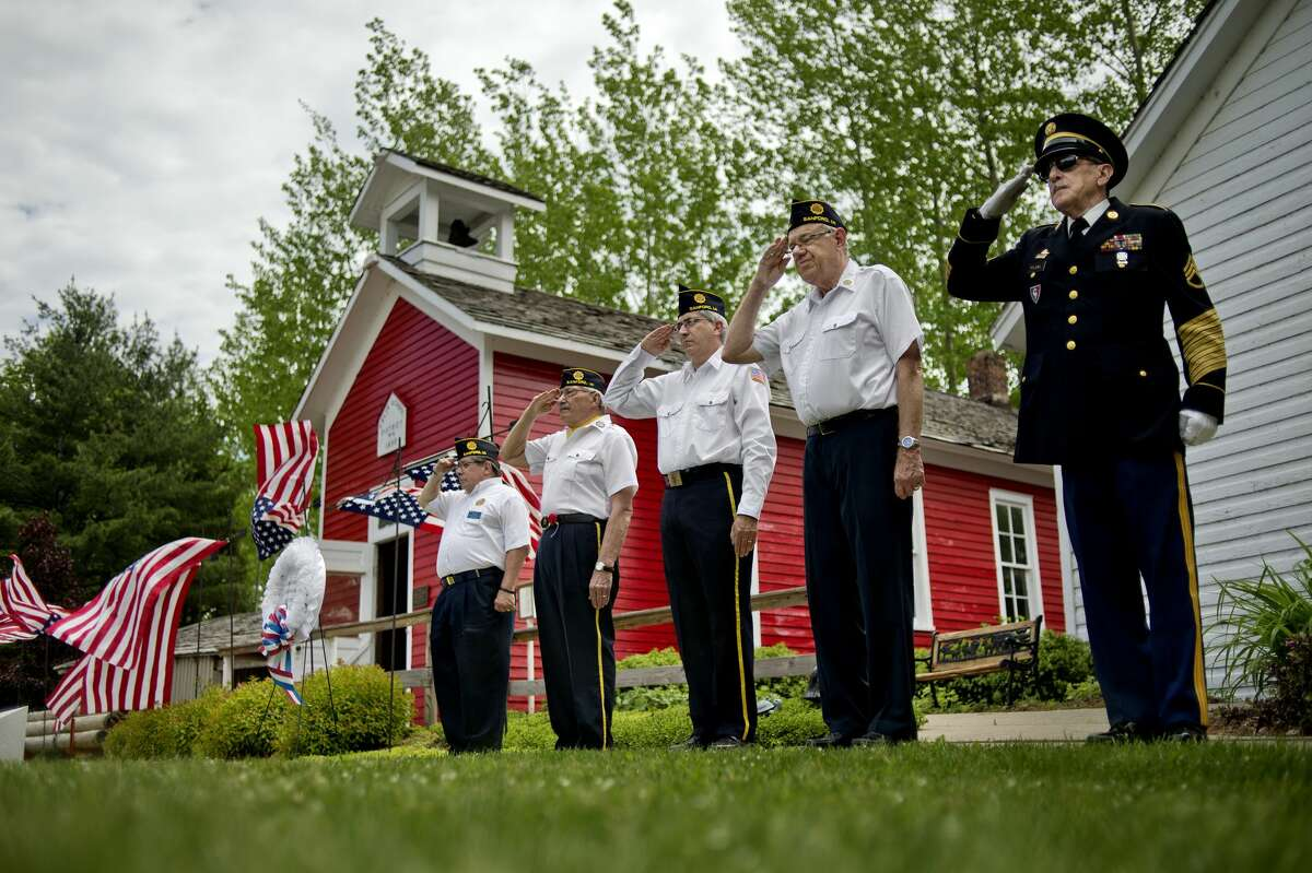NICK KING | nking@mdn.net From left, Sanford American Legion Post 443 members Mark Authier, Don Spaulding, David Yahr, Kent Toner and Jim Fleming salute during a veterans' tribute ceremony on Saturday at the Sanford Centennial Museum. 2016