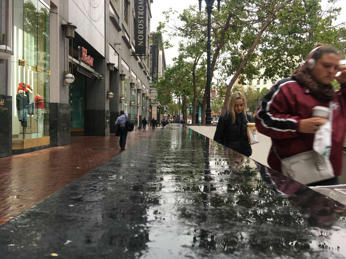 The sidewalks in San Francisco were slick on Wednesday morning, May 23, 2018 after a heavy fog enshrouded the city overnight.