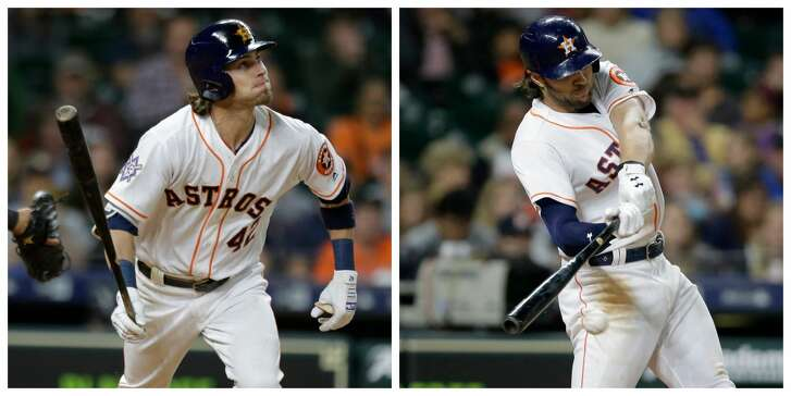The Astros' Josh Reddick, left, is going on the disabled list. The Astros have recalled Jake Marisnick.