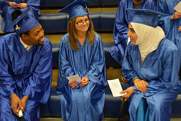 """All that stands between the graduate and the top of the ladder is the ladder. You decide what success looks like to you and which ladder to climb,"" Middletown Associate Superintendent of Schools Enza Macri told the 50 students during Tuesday night's adult education commencement exercises at the high school."