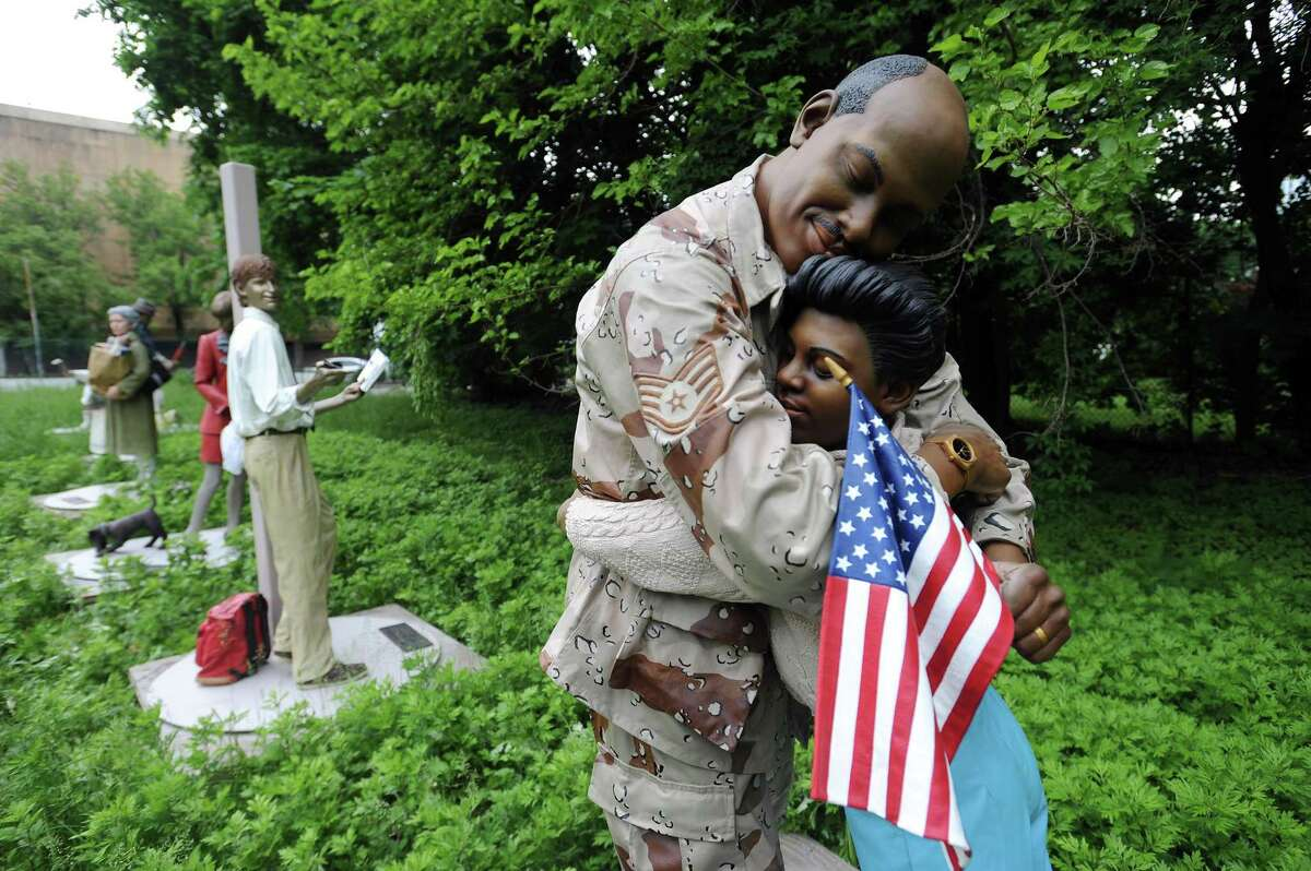 """Seward Johnson's """"Come Home"""" is one of more than 30 statues that are temporarily sitting inside an empty lot on Greyrock Pl. in downtown Stamford, Conn. on Tuesday, May 22, 2018. The statues will soon be placed around the city as part of Stamford Downtown's annual summer art display."""