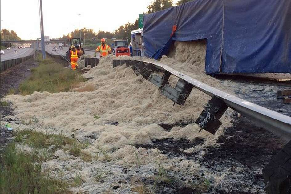 A semi truck that flipped on its side on northbound Interstate 5 in  Federal Way early Wednesday morning spilled 40,000 pounds of feathers on  the roadway, blocking nearly all lanes of traffic.