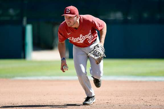 Cardinal's first baseman Andrew Daschbach takes a ground ball during team practice at Stanford University in Stanford, Calif., on Tuesday May 22, 2018.