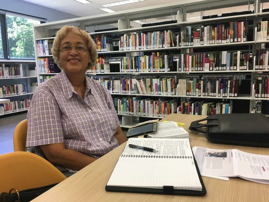 Emily Reddix said she has been visiting the Katherine Tyra Branch Library at Bear Creek for more than 30 years. She was at the library April 30, when it reopened for the first time after Hurricane Harvey. Photo: Karen Zurawski / Karen Zurawski