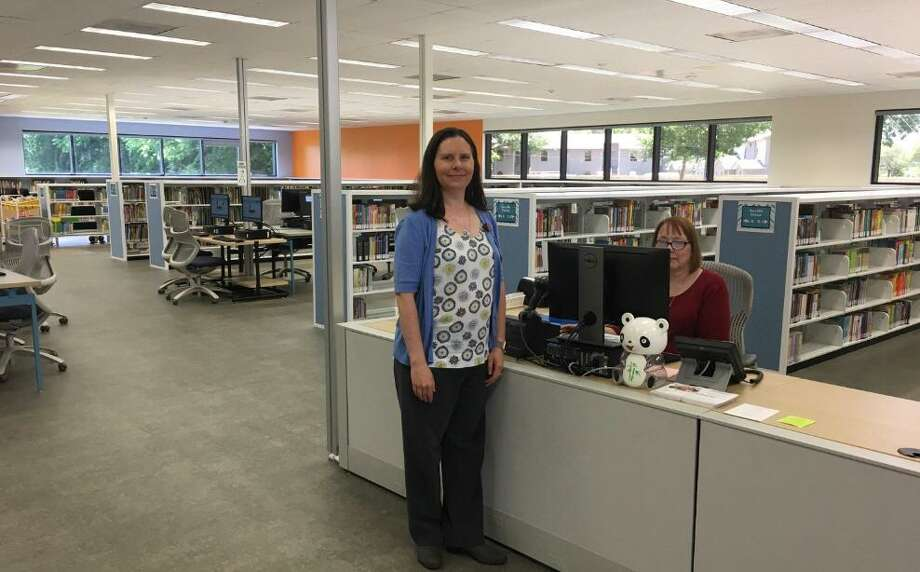Amy Campbell, branch library, Katherine Tyra Branch Library at Bear Creek invites people to check out the reopened library. Photo: Karen Zurawski / Karen Zurawski