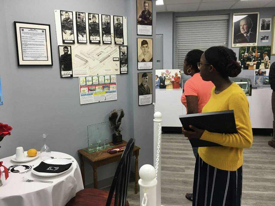 Nia Adeogun, who won the Katy VFW 9182 Youth Essay contest, checks out the rebuilt Katy Veterans Memorial Museum at 6202 George Bush Drive. She was accompanied by her mother, Nichele Adeogun. The VFW celebrated the reopening of its post and museum on May 17. Photo: Karen Zurawski / Karen Zurawski