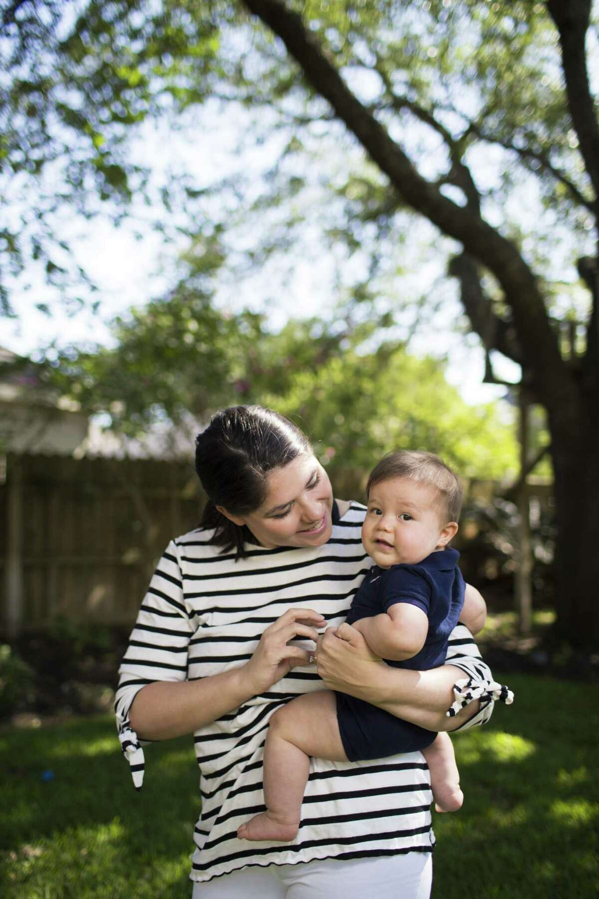 Jessica Dolan, a Neonatal Intensive Care Unit (NICU) nurse at Memorial Hermann Memorial City Medical Center holds her baby Reid Dolan at her home in Sugar Land.