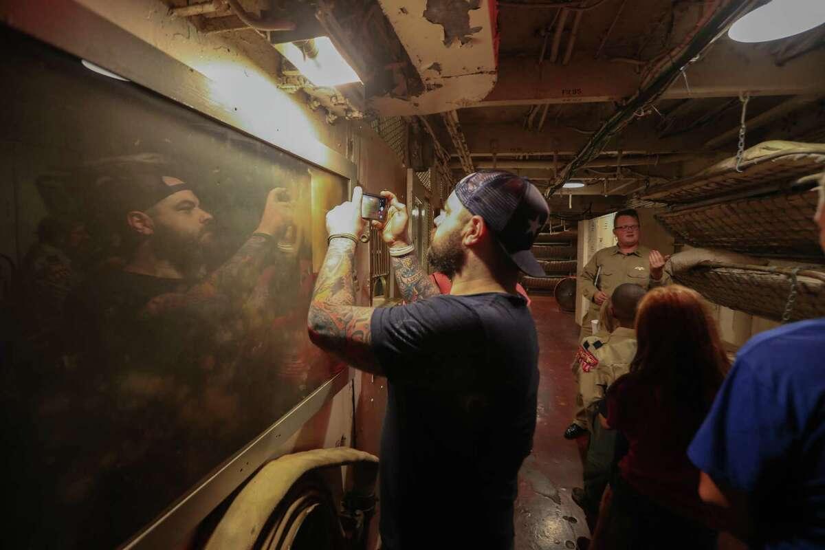 Houston Chronicle Reporter Craig Hlavaty takes photos on Battleship Texas.