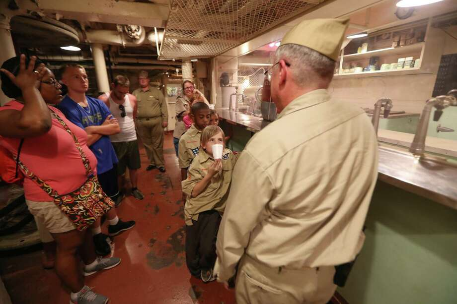 Paul Thorne leads Cub Scouts and their parents on a tour of the Battleship Texas. Photo: Steve Gonzales, Houston Chronicle / Houston Chronicle / © 2018 Houston Chronicle