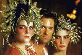 "Kim Cattrall, from left, Kurt Russell and Suzee Pal in a scene from the movie, ""Big Trouble in Little China."""
