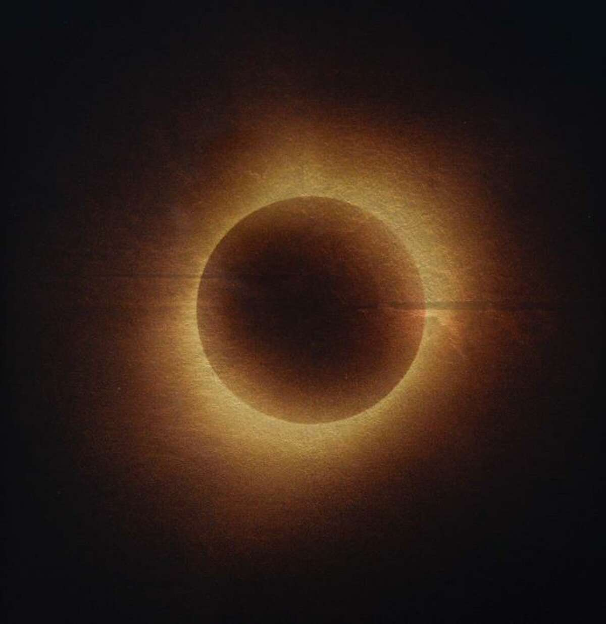 """""""Solar Eclipse, Nebraska, August 21st, 2017"""" is among works in Kate Breakey's show """"Golden Hour,"""" on view through June 23 at Catherine Couturier Gallery."""