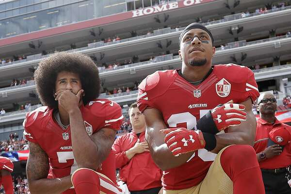 "FILE - In this Oct. 2, 2016, file photo, San Francisco 49ers quarterback Colin Kaepernick, left, and safety Eric Reid kneel during the national anthem before an NFL football game against the Dallas Cowboys in Santa Clara, Calif. The NFL players' union has filed a non-injury grievance on behalf of free agent safety Eric Reid. The NFLPA cites one team appearing ""to have based its decision not to sign a player based on the player's statement that he would challenge the implementation of a club's policy prohibiting demonstration� during the national anthem. (AP Photo/Marcio Jose Sanchez, File)"