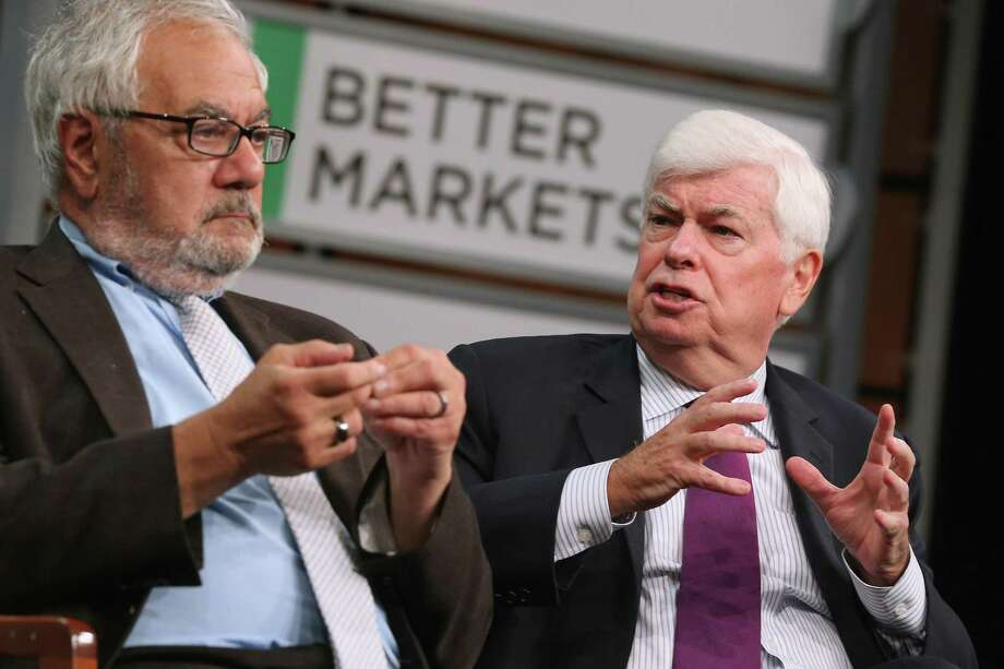 File photo of former Rep. Barney Frank (D-MA) (L) and former Sen. Chris Dodd (D-CT) talking about their hallmark and namesake legislation, the Dodd-Frank Wall Street reform law. The House voted 258-159 on Tuesday to approve legislation rolling back the law, notching a legislative win for Trump, who made gutting the landmark law a campaign promise. The Republican-led legislation, pushed by Wall Street banks as well as regional banks and smaller institutions, garnered 33 votes from House Democrats. Similarly, the bill splintered Democrats into two camps when the Senate voted 67-31 to approve it in March. Photo: Chip Somodevilla /Getty Images / 2015 Getty Images