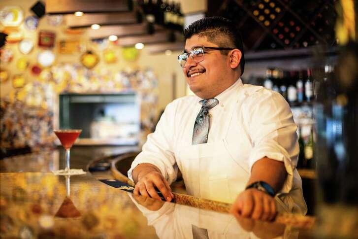 Erick Balbuena, a bartender at Piatto Ristorante, poses for a portrait Friday May 18, 2018. (Michael Starghill, Jr.)