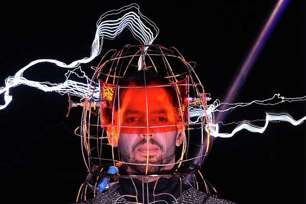 """Magician David Blaine stands under lighting bolts at the start of his performance, """"Electrified"""", in New York, October 05, 2012."""