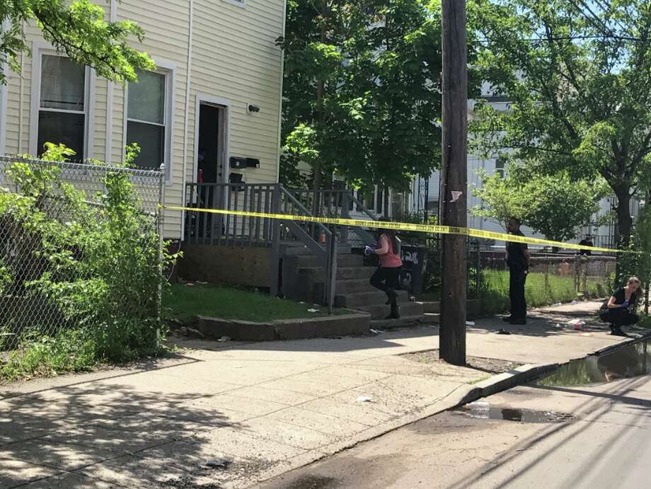 New Haven Police look for a shooter who shot a 25-year-old in the leg. The victim is in stable condition. Area schools are on lock down as the search for the shooter continues. Photo: Jessica Lerner