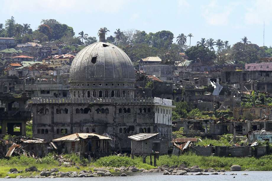 Weeds grow on the ruins of Marawi city exactly a year after Filipino Muslim militants laid siege to the city. Thousands of displaced residents remain in emergency shelters. Photo: Associated Press