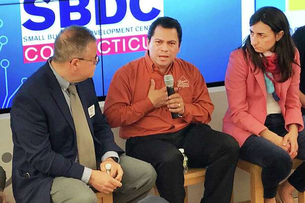 Elmer Palma, owner of Elmer's Diner, talks about his business as other panelists look on during a Small Business Development Center and SCORE panel discussion held Tuesday, May 22, 2018, at the Microsoft Store at Danbury Fair in Danbury, Conn.