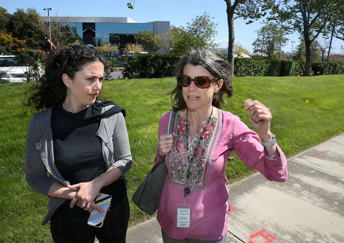 Deputy director Christina Briggs (left) of Economic Development/assistant to the City Manager, and Economic Development director/ chief innovation officer Kelly Kline (right) show one of the two buildings which Facebook leased behind them on Thursday, April 19, 2018, in Fremont, Calif.