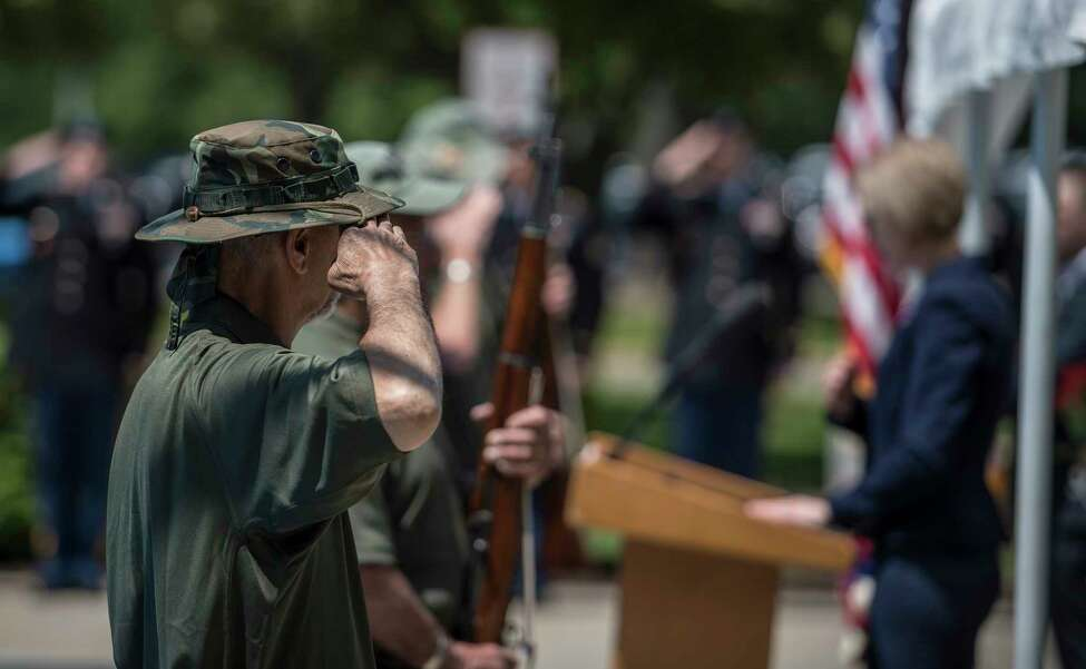 Members of the Tri County Council Vietnam-Era Veterans Color Guard hand salute after posting the colors at the 25th annual Memorial Day Ceremony at the Department of Labor on the Harriman Campus Wednesday May 23, 2018 in Albany, N.Y. (Skip Dickstein/Times Union)