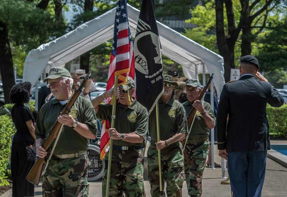 Members of the Tri County Council Vietnam-Era Veterans Color Guard retire the colors at the the 25th annual Memorial Day Ceremony at the Department of Labor on the Harriman Campus Wednesday May 23, 2018 in Albany, N.Y. (Skip Dickstein/Times Union)