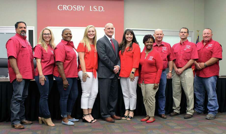 The Crosby ISD Board of Trustees named former Rusk ISD Superintendent Scott Davis as the lone finalist to be the new Crosby ISD superintendent. Davis is with his daughter Kylie (left) and wife Kristie (right) and Crosby ISD board members. Photo: Kaila Contreras