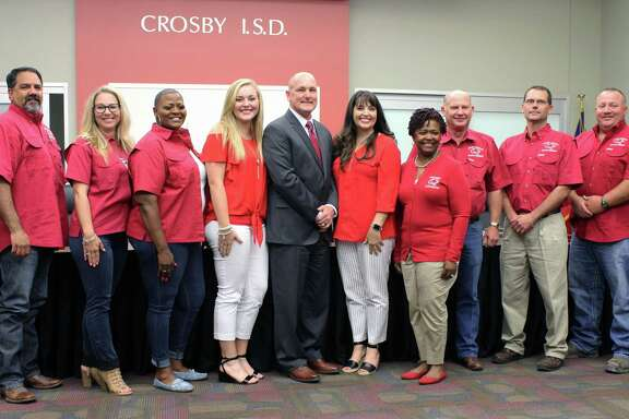 The Crosby ISD Board of Trustees named former Rusk ISD Superintendent Scott Davis as the lone finalist to be the new Crosby ISD superintendent. Davis is with his daughter Kylie (left) and wife Kristie (right) and Crosby ISD board members.