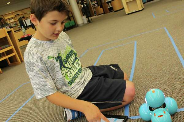 Cider Mill School third-grader William Viggiano, 9, programs instructions into his Dash and Go robot as a part of the new Ready Access Digital Learning program being implemented district-wide in Wilton public schools.