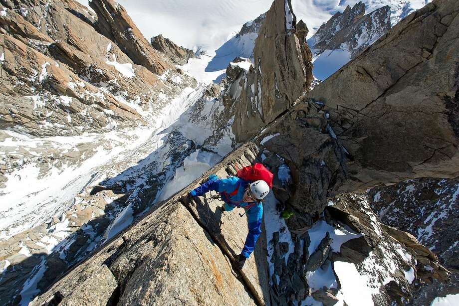 """A climber makes a careful ascent of a steep vertical crevice in the documentary """"Mountain."""" Photo: Greenwich Entertainment"""