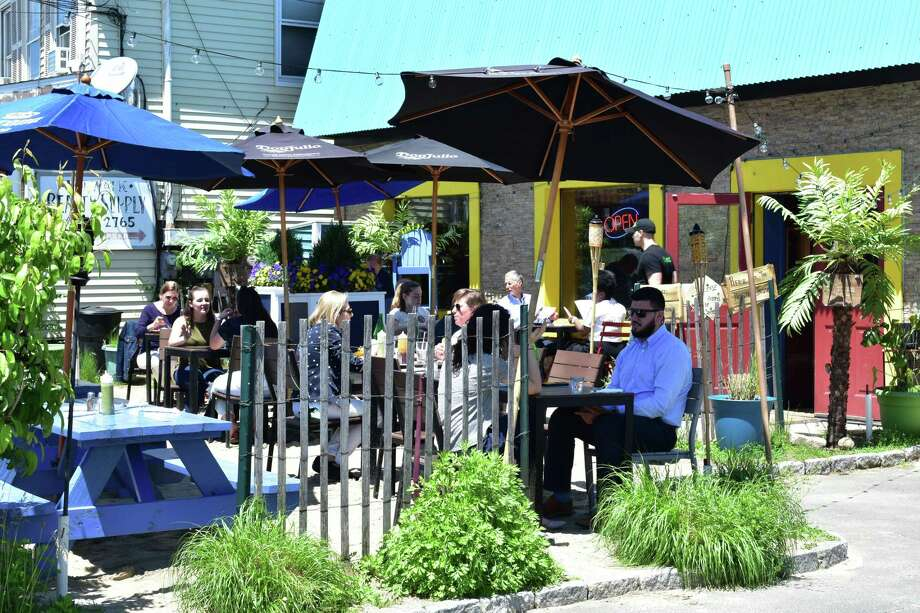 Diners enjoy a sunny noon hour on Wednesday, May 23, 2018, at the outdoor patio of Valencia Luncheria at 164 Main St. in Norwalk, Conn. Photo: Alexander Soule / Hearst Connecticut Media / Stamford Advocate