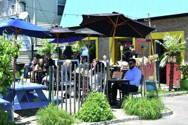 Diners enjoy a sunny noon hour on Wednesday, May 23, 2018, at the outdoor patio of Valencia Luncheria at 164 Main St. in Norwalk, Conn.