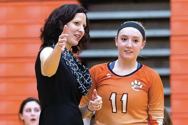 Edwardsville coach Jami Parker directs setter Rachel Verdun (11) during a match last season in Edwardsville.