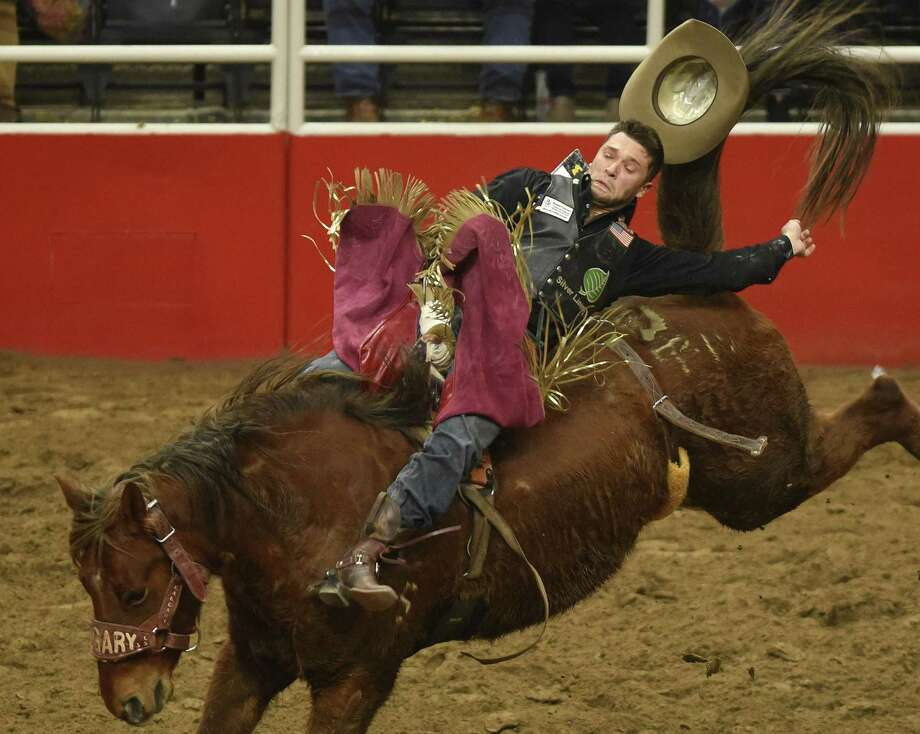 Caleb Bennett hangs on to win the bareback riding competition during the finals of the San Antonio Stock Show & Rodeo in the AT&T Center on Saturday, Feb. 24, 2018. Photo: Billy Calzada, Staff / San Antonio Express-News / San Antonio Express-News