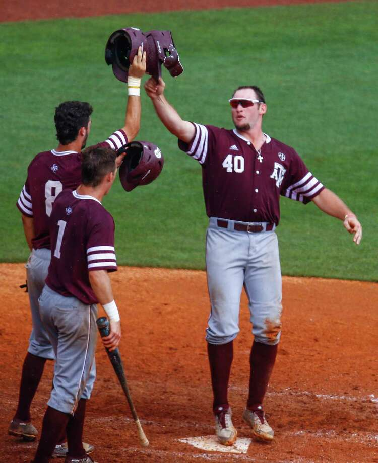 Texas A&M infielder Chris Andritsos (40) celebrates with Braden Shewmake (8) and Michael Helman (1) after hitting a three run homer during the seventh inning of a Southeastern Conference Tournament NCAA college baseball game against Georgia, Wednesday, May 23, 2018, in Hoover, Ala. (AP Photo/Butch Dill) Photo: Butch Dill, Associated Press / Associated Press