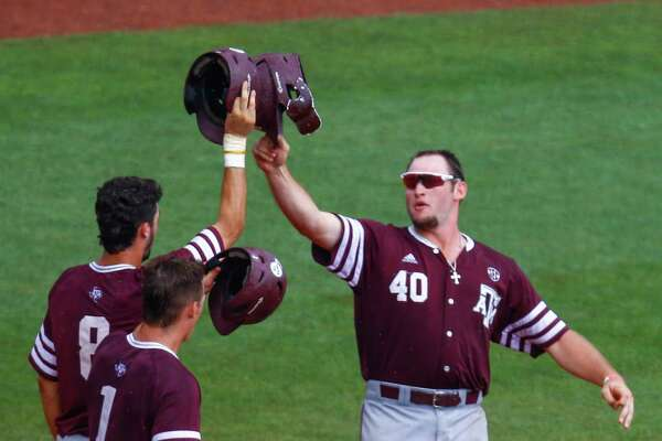 Texas A&M infielder Chris Andritsos (40) celebrates with Braden Shewmake (8) and Michael Helman (1) after hitting a three run homer during the seventh inning of a Southeastern Conference Tournament NCAA college baseball game against Georgia, Wednesday, May 23, 2018, in Hoover, Ala. (AP Photo/Butch Dill)