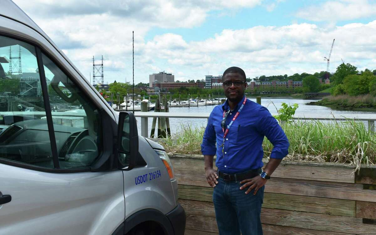 Phlatbed founder Alani Kuye on Wednesday, May 23, 2018, in Norwalk, Conn. Kuye's startup envisions an Uber-like service for people to connect with truck owners for help moving bulky items.