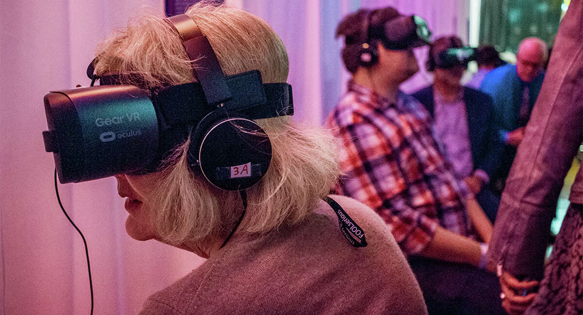Participants explore SIFF's VR Zone at the bottom of Pacific Place.