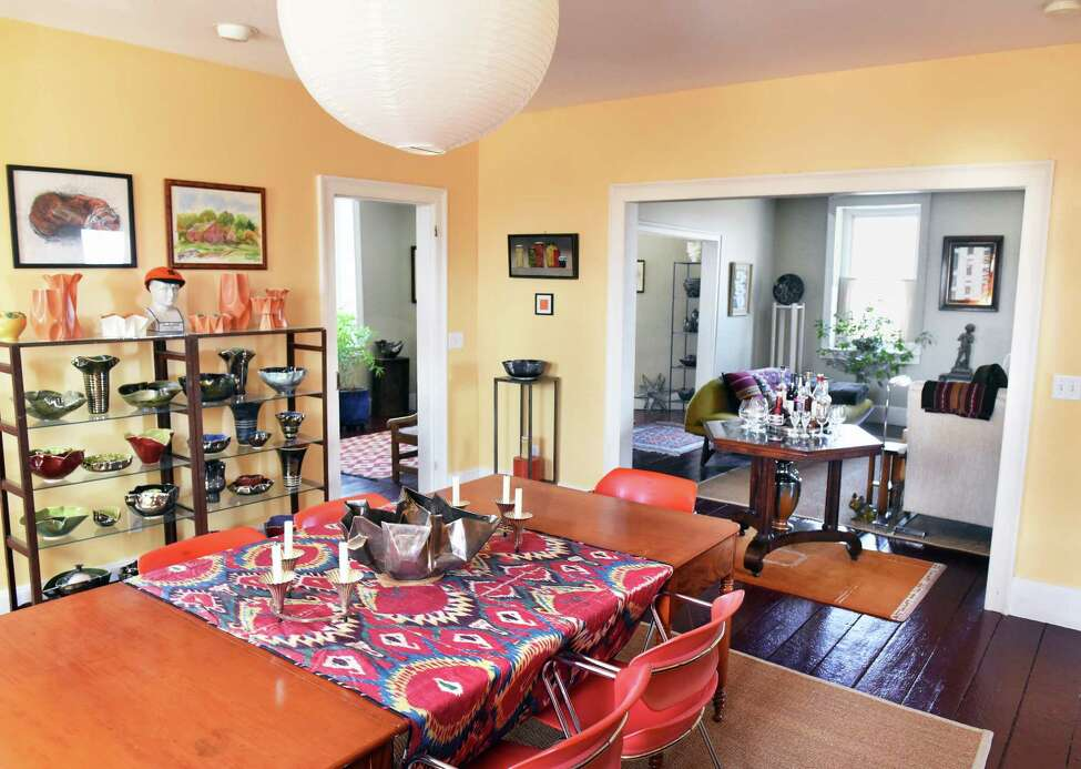 Dining room, left,and parlor at Bob Pesce's historic octagon home Wednesday April 11, 2018 in Columbiaville, NY. (John Carl D'Annibale/Times Union)