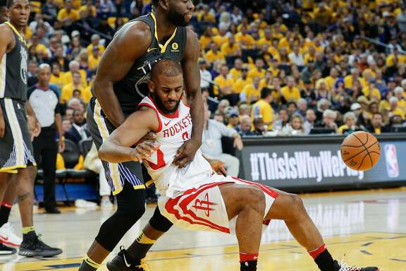 Golden State Warriors' Draymond Green tries to hold up Houston Rockets' Chris Paul in the third quarter during game 4 of the Western Conference Finals between the Golden State Warriors and the Houston Rockets at Oracle Arena on Tuesday, May 22, 2018 in Oakland, Calif.