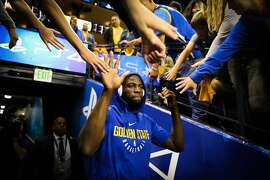 Warriors player Draymond Green greets fans on his way to warm up ahead of Game 4 of the Western Conference finals between the Golden State Warriors and the Houston Rockets at Oracle Arena in Oakland, California, on Tuesday, May 22, 2018.