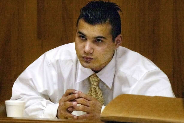 John Allen Rubio is seen in court during his trial in Brownsville, Texas, Monday, Oct. 20, 2003. Rubio is accused of killing and decapitating three small children, two his own, with the assistance of his common-law wife. (AP Photo/The Brownsville Herald, Kris Holland)  HOUCHRON CAPTION (10/21/2003)(10/22/2003):  Rubio.