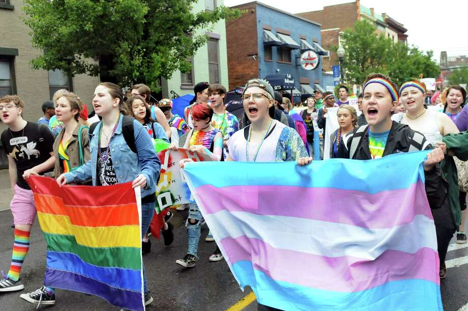 Pride Center Youth proclaim their existence as they march during the Capital PRIDE Parade on Saturday, June 11, 2016, in Albany, N.Y. The annual parade, festival and rally celebrates the Lesbian, Gay, Bisexual, Transgender and Queer community with entertainment and family-friendly activities. (Cindy Schultz / Times Union) Photo: Cindy Schultz / Albany Times Union